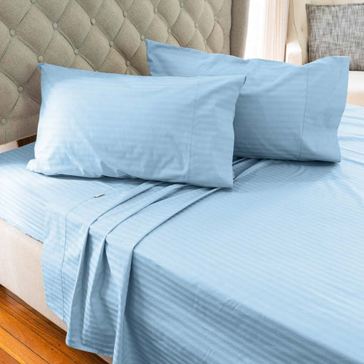Light Blue Cotton Sheets on a bed