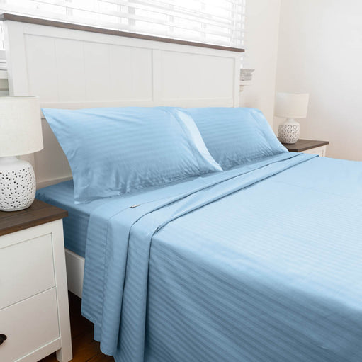 Bed set up with Light Blue Cotton Sheets