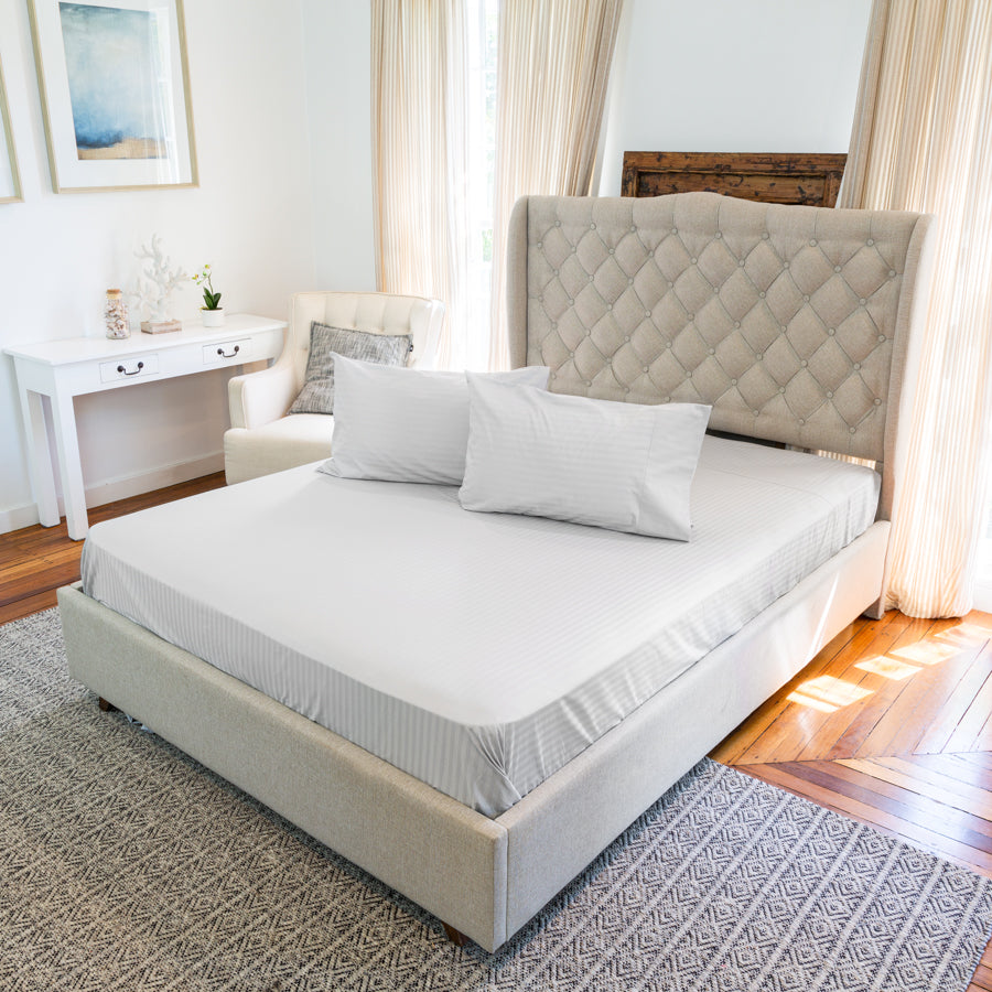 Bedroom with a bed and pillows with Silver Cotton Royal Deluxe Dream Sheets on top