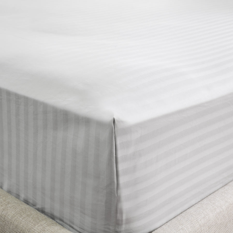 Corner of a bed with the Silver Cotton Royal Deluxe Dream Sheets on top