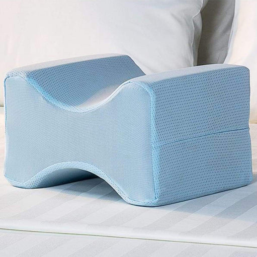 Lumbalign Leg Pillow on a bed