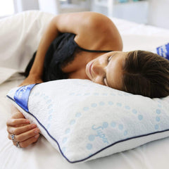 Woman sleeping on the Every Comfort Pillow