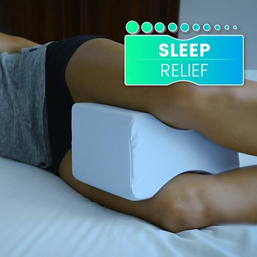 Woman's knees using a Lumbalign Leg Pillow with highlighted sleep relief benefits