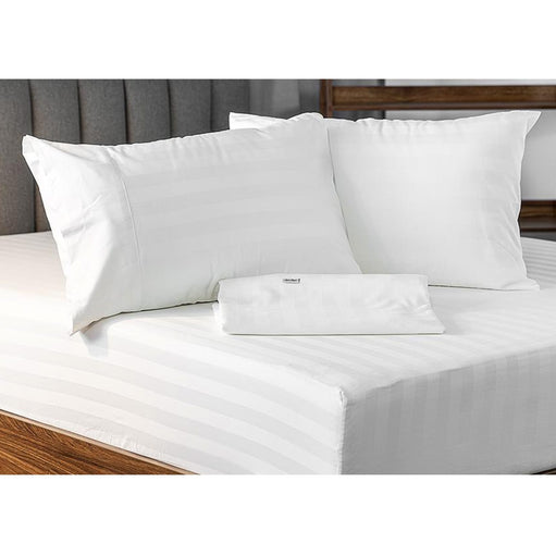 Royal Deluxe Super Weave Dream Sheet Set on a bed with an extra folded sheet