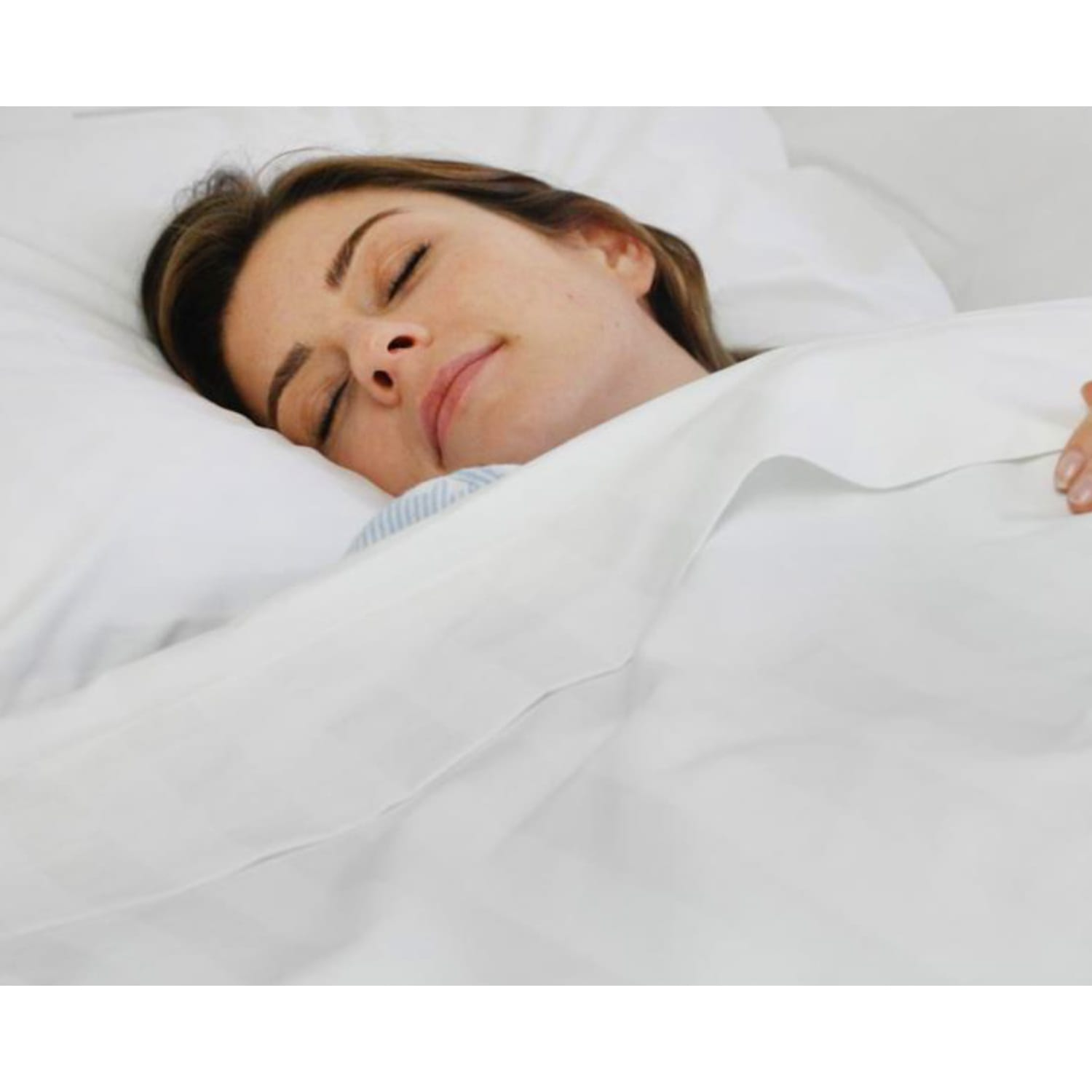 Woman laying in bed with Royal Deluxe Super Weave Dream Sheet Set