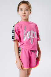 HYPE X RIVER ISLAND BRIGHT PINK TAPED SCRIPT KIDS T-SHIRT