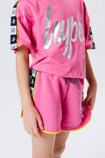 HYPE X RIVER ISLAND BRIGHT PINK TAPED KIDS RUNNER SHORTS