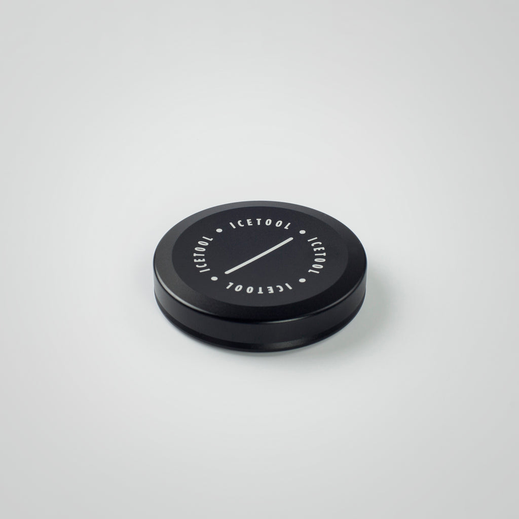 Icetool Mini Can made of black aluminum on a white background. A perfect container for nasal snus and snuff.