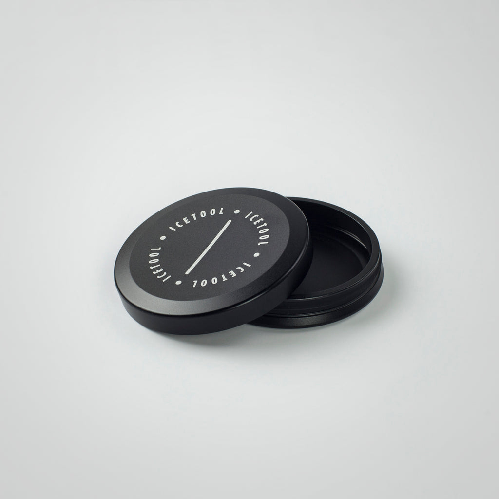 Icetool Mini Can made of black aluminum on a white background. A perfect container for nasal snus and snuff. Open.