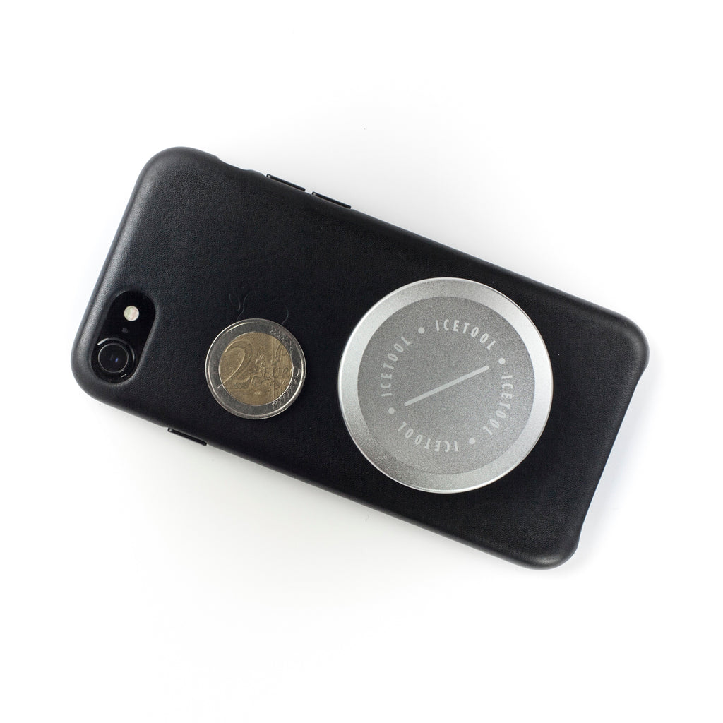 Icetool Mini Can for nasal snus - Silver colour - Placed on an iPhone next to a two euro coin to show the size.
