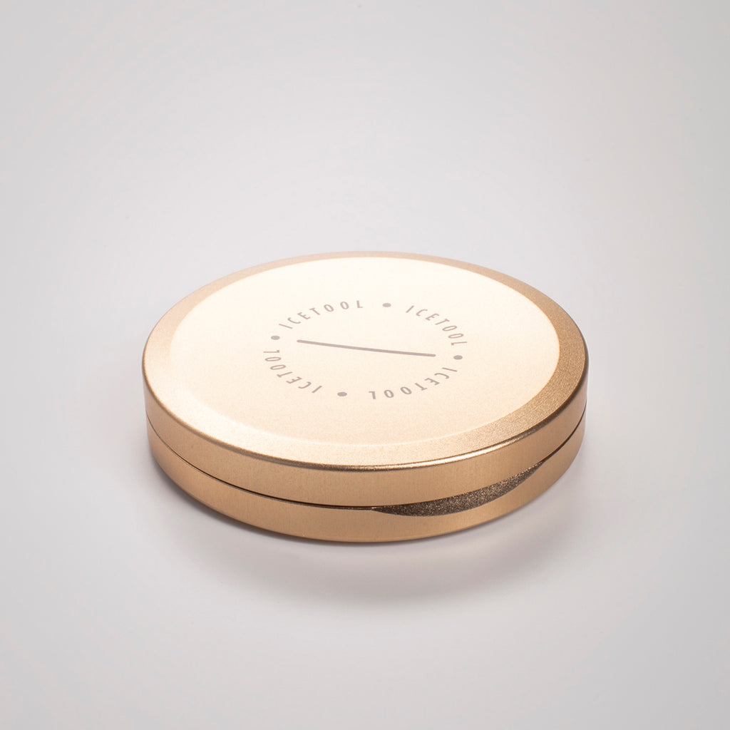 Icetool Slim Can for portion snus and nicotine pouches. Gold and champagne color anodised aluminum.