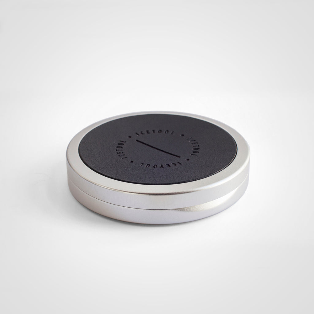 Icetool Slim Can Leatheface for portion snus and nicotine pouches - Silver aluminum with a custom made black leather covered lid.