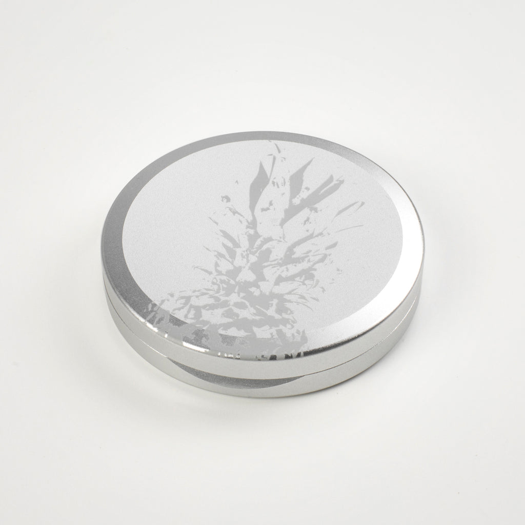 Icetool Slim Can for portion snus and nicotine pouches. Silver color anodised aluminum with pineapple graphics.