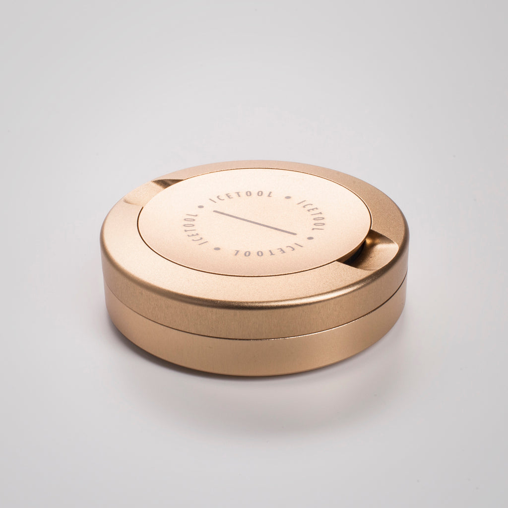 Icetool The Can golden champagne color  aluminum snus container for portion snus and nicotine pouches. Space for used portions under the lid. On a white background.