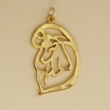 Hand hammered, US made gold vermeil poodle head pendant.