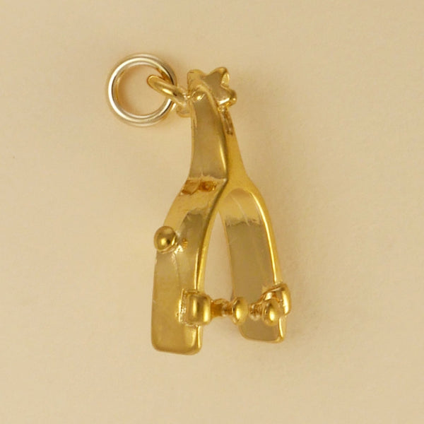 US made gold vermeil spur charm.