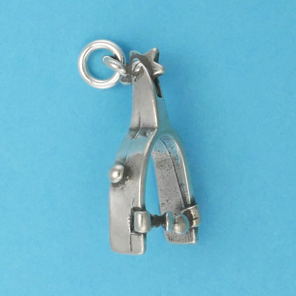 US made sterling silver spur charm.