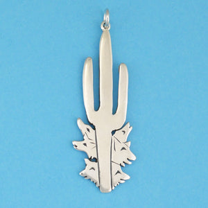 US made sterling silver saguaro and coyotes pendant.