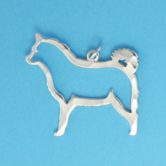 Hand hammered, US made sterling silver Siberian Husky dog charm.