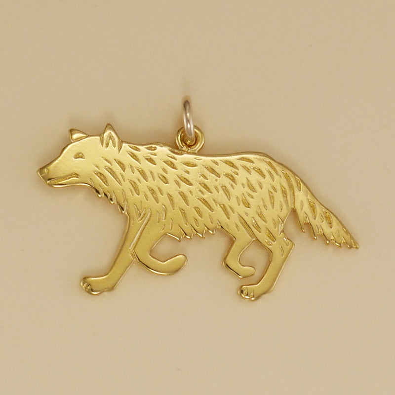 US made gold vermeil running wolf charm.