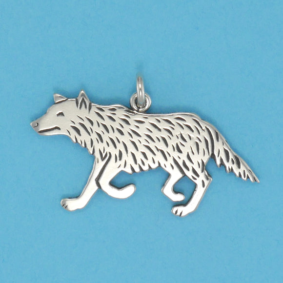 US made sterling silver running wolf charm.
