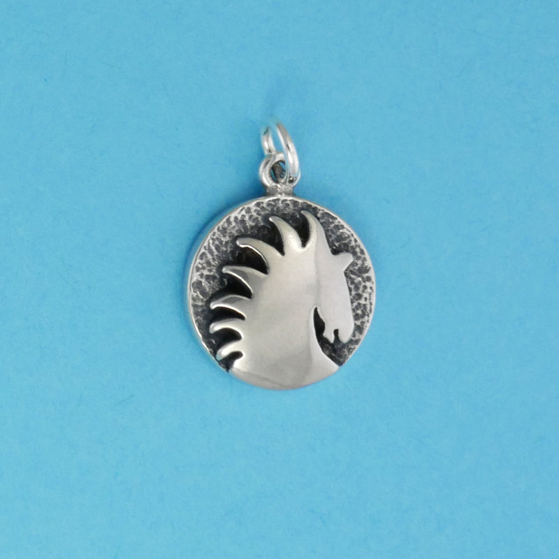US made sterling silver sunburst horse head charm.