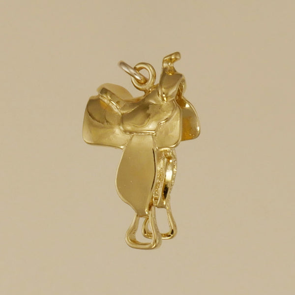 US made gold vermeil western saddle charm.