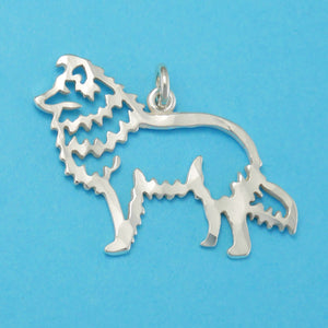 Hand hammered, US made sterling silver shetland sheep dog charm.