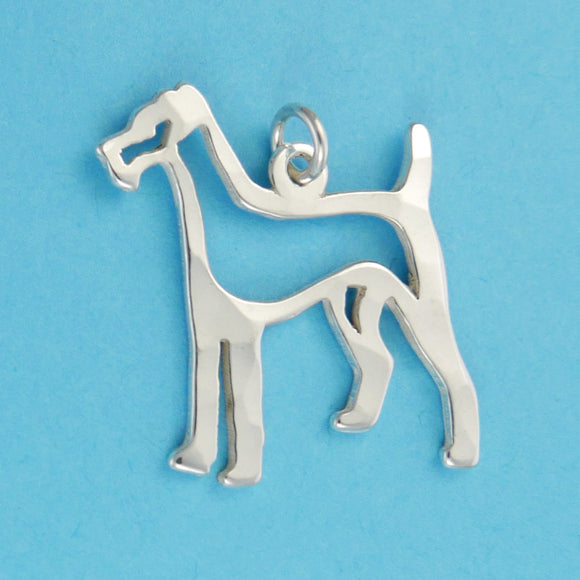Hand hammered, US made sterling silver fox terrier charm.