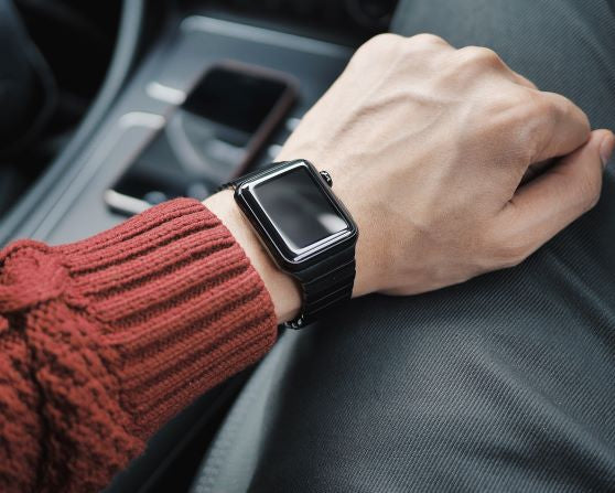 Stainless steel apple watch band on the wrist