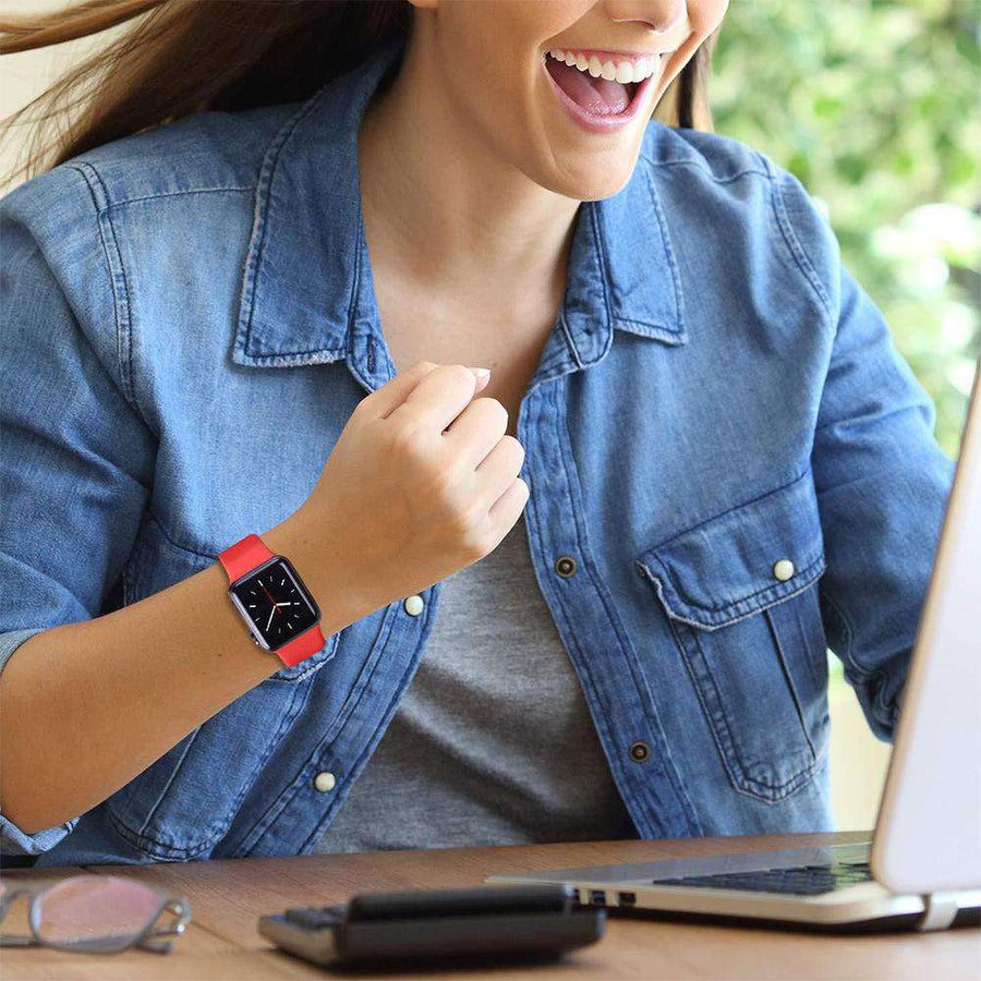 Solid red silicone sports apple watch band on the wrist - Veecircle premium silicone band