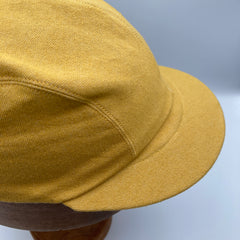 Side view of mustard yellow denim basic cap from the capalog