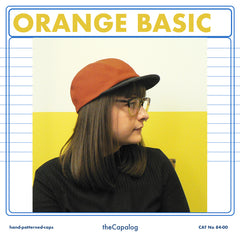 Orange & charcoal basic cap available in 7 sizes, £35 inc p&p