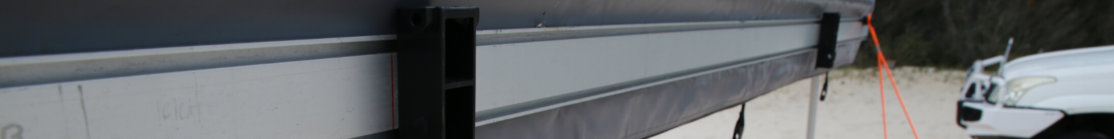 Close up of RacksBrax Holders attached the awning accessory