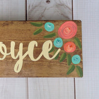 hand painted wood signs with teal and coral flowers