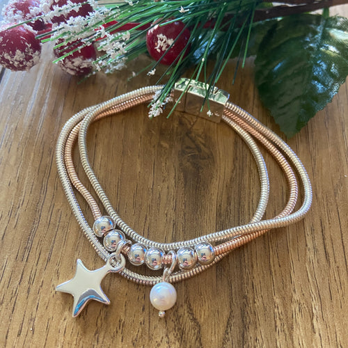 Triple strand Bracelet with star & pearl charms