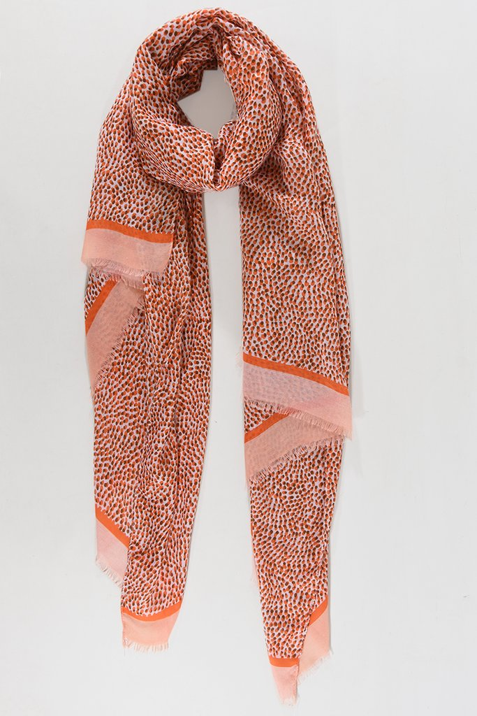 bright orange coloured scarf with microdot pattern