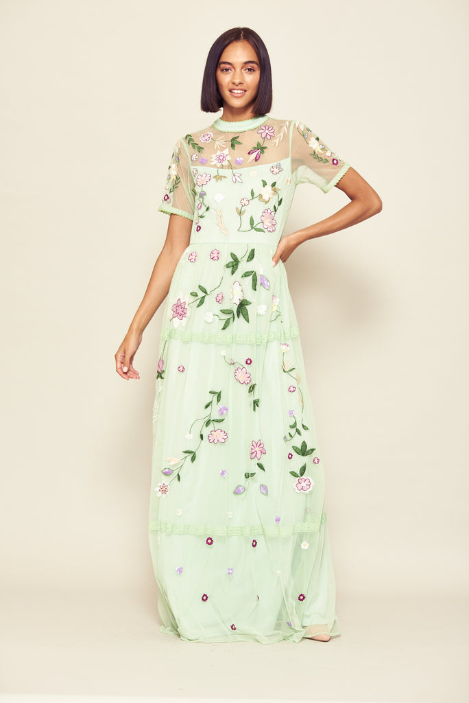 Mint green maxi dress with short sleeves and floral embellishment