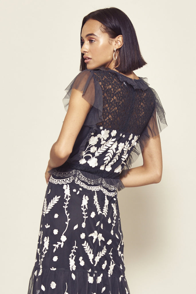 Dark grey mid length dress with white floral design