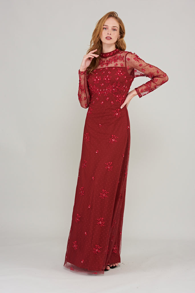 Burgundy maxi dress with sheer full-length sleeves and floral embroidery
