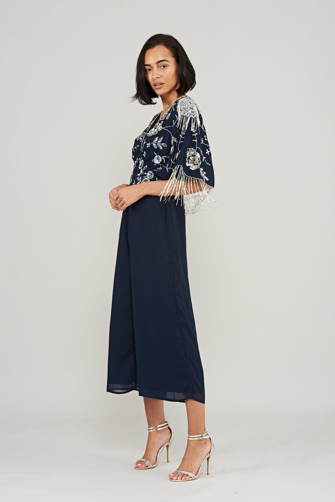 Navy jumpsuit with kimono sleeves and buttons