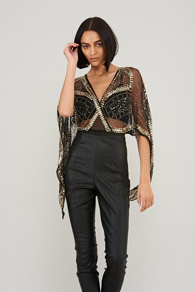 Bodysuit with cape sleeves and gold embellishments