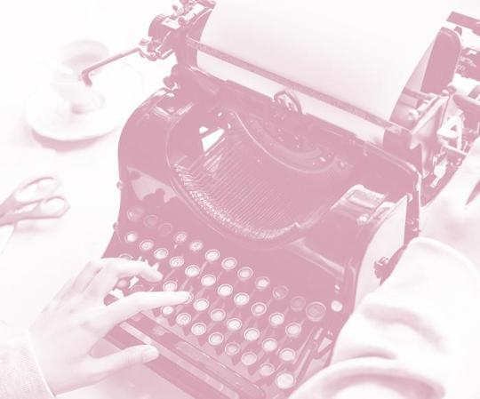 image of a person using a typewritter with a pink overlay