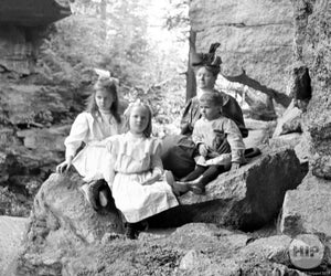 Woman and Children on Rocks