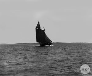 Sailboat with Dark Masts Sailing through the Waters of an Unspecified Region in New England