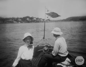 Woman posing on boat.