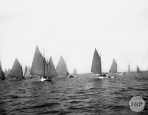 Unidentified sailboats on water.