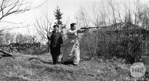Man and woman with rifles in Cape Porpoise.