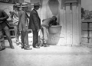 Men in Fedora styled Hats and Suits Waiting in Line at Coney Island Water Fountain
