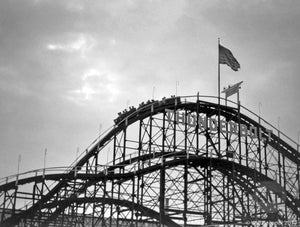 Thunderbolt Roller Coaster at Coney Island with Steeplechase Park Pavilion of Fun in the Background